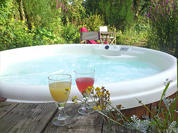 2 refreshing drinks sitting beside the hot tub